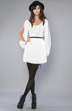 Love this look...the dress, tights and boots are so me.  From Karmaloop