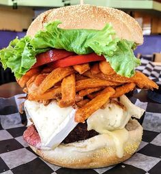 The BRIE BURGER: angus beef burger topped with crispy bacon, fried onions, Brie cheese, and sweet potato fries!
