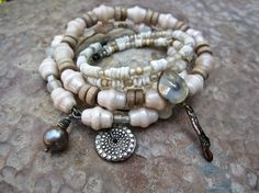 Love the soft 'beachy' colours of tan and cream. Mermaids Endowment. Tribal gypsy bangle stack bracelets