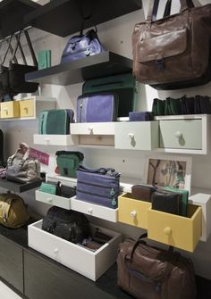 "KIPLING, London, UK,""Drawers are used to give depth to the display and a homely feel to the brand"", design by Uxus, Amsterdam, The Netherlands, pinned by Ton van der Veer"