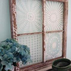 Crochet doilies behind the window.