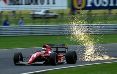 Jean Alesi, Ferrari 643, #28, (finished 3rd),  Portuguese Grand Prix, Estoril, 1991. -- Such sparks. Wow.