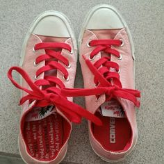 Dr. Seuss Converse Pink All-star Converse with red laces and black Dr. Seuss characters around sole.  These are in very good condition.  There is a slight crack in the plastic of the one shoe, but otherwise these have had mild use.  They are a women's size 5, but as Converse run a half size + big, they would easily fit a 5.5 or even a 6. Converse Shoes Sneakers