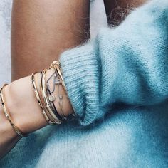 Things you'll never want to take off: dainty boho bracelets and a blue cashmere sweater