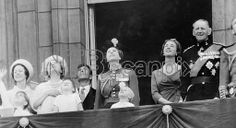 London : All eyes are turned upwards as members of the Royal Family watch a fly - past of Royal Air Force planes from the Balcony of Bucking...