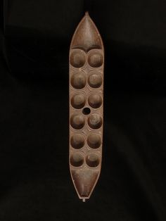 Mancala, Bidjogo, Guinea-Bissau Mancala is one of the world´s oldest games. It is widely played in Africa. The boat shape of the game board is typical for the Bidjogo and canoes is of big importance for the people.  1200 €