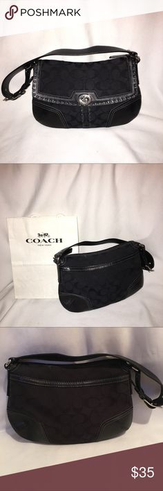 "Coach canvas and leather signature bag In excellent condition inside and out Black coach canvas and leather signature logo bag . Has 1 slip pocket and 1 zip pocket inside and 1 outside pocket on back.Measurements approximately 11"" across  7"" height 8"" strap drop 3"" depth Coach Bags Shoulder Bags"