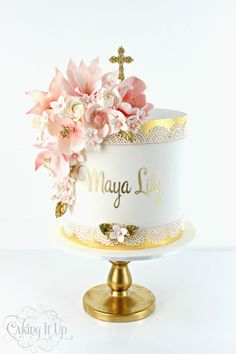 1 tier Christening cake featuring beautiful sugar flowers, gold lace trim, fondant cross cake topper and signature hand printed name. www.facebook.com/cakingitup