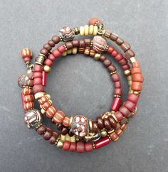Indonesian bead glass, ceramic, brass and African beaded wrap around memory wire bracelet