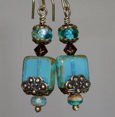 """Aqua Picasso earrings Picasso bead earrings by CharmingLifeJewelry Handmade item czech glass beads, brass kidney ear wire, aqua opaline czech glass beads, swarovski crystals, brass accents"" (quote) via etsy.com"