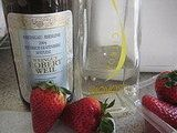 Redhead in bed - serves 10    3 pounds strawberries, hulled and coarsely chopped  2/3 cup sugar  1/2 cup plus 2 tablespoons citrus vodka  1/4 cup fresh lime juice  Ice  1/3 cup chilled Riesling