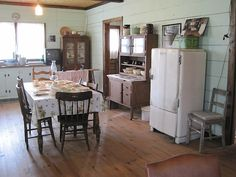 Farm Kitchen (stand alone pieces instead of lots of built in cupboards -center table rather than an island.)