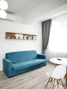 Accente de turcoaz și gri pe fundal alb într-un apartament din Iași | Jurnal de Design Interior