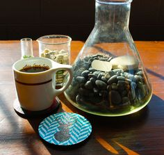 Loving the Geek-Chic setup of this coffee moment featuring a zen-garden using beakers, and Flox 'Deer & Deer & Deer, Oh My!' Rubber Coasters.  Oh and plenty of sunshine.
