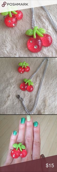 """Hot Pink Kawaii Fruits Cherry Ring & Necklace Set Check out this adorable hot pink cherries jewelry set. So Kawaii!!! Both pieces include hot pink glitter cherries with green leaves and rhinestones embedded in them. The necklace measures about 13"""" long from the top of the clasp, to the bottom of the cherries. The ring is about 1"""" across and set on a silver tones adjustable ring base. Would look adorable with a Kawaii, pinup or rockabilly retro-inspired outfit! Tagged Hello Kitty but not a…"""