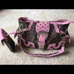 Pink leather with Camo and bling purse Super cute pink leather purse with Camo and bling accents. Has remove able cell phone holder and lots of pockets!!! Only carried for a week I just have too many purses!!! Bags Shoulder Bags