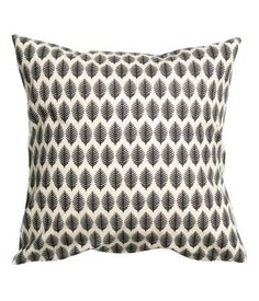 $6 Cushion cover in cotton fabric with a printed pattern. Concealed zip.