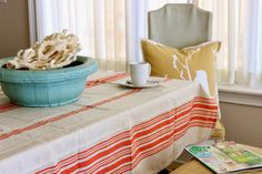 Are we all dying for spring?....Run to HomeGoods for some colorful accents like this tablecloth and pillow!