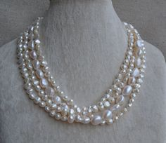 baroque pearl necklace -4 rows pearl necklace,18 inches 6-12mm Ivory Freshwater pearl necklace,real pearl necklace, statement necklace by goodgoodjewelry on Etsy https://www.etsy.com/listing/84550449/baroque-pearl-necklace-4-rows-pearl