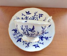 This absolutely stunning teacup and saucer set was made in 1891 according to its stamp. The royal blue birds against the white porcelain and