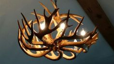 This antler chandelier can add a warm, rustic charm to your home. Our furniture expert, Tina found this one in Indiana while shopping for the best made in America solid wood furniture. Can you picture this in your bedroom or your dining room? What other accessories would be a must have to make your look complete? #home_decor #craftsmanship_furniture #unique_lighting   Houston TX   Gallery Furniture  
