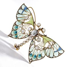 Vever ~ Gold, diamond, pearl and plique-á-jour enamel butterfly brooch ~ 1900