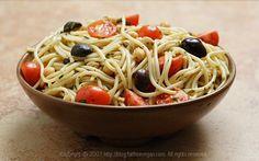 Sicilian Market Spaghetti. Ingredients: olive oil, garlic, red onion, pepper, orange zest, oregano, red chile pepper flakes, spaghetti, chickpeas, basil, black olives, cherry tomatoes