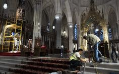 Only the finest: Workers put finishing touches on the main altar of St. Patrick's Cathedral in preparation for Pope Francis's visit to the church later this week in New York