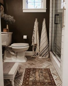 Get ideas for decorating a brown bathroom thanks to this stunning space. The paint color is Dirty Chai, a warm nutty brown by Clare.