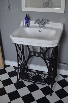 Singer Sink. Early 20th Century Singer sewing machine base installed into bathroom with 1920s basin mounted on top