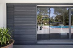 Find out all of the information about the PROFILS SYTEMES product: sliding shutter TAOS®. Contact a supplier or the parent company directly to get a quote or to find out a price or your closest point of sale. Exterior Blinds, Window Shutters Exterior, Interior And Exterior, Interior Paint, Metal Shutters, Aluminium Shutters, Sliding Door Panels, Door Design, House Design