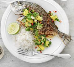 Rub sea bream or mackerel with Cajun spice, bake whole and serve with a cool and fresh avocado sauce and rice