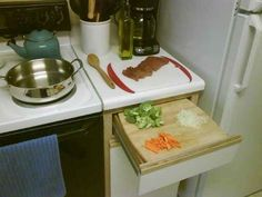 Small kitchen? Cutting boards and drawers work wonders. | 37 Essential Life Hacks Every Human Should Know