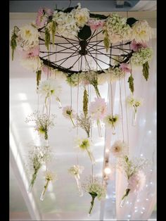 Pollen and Patina hanging antique bike wheel floral chandelier