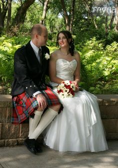 Canadian wedding with a white gown and the groom in a kilt