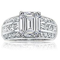 Gwen Emerald Cut with Channel Princess & Pave Rounds CZ Ring... The Gwen ring features a 4.0 carat emerald cut cubic zirconia center stone set in a wide gold band, accented by  channel set princess cut squares, and pave set rounds.   Approximately 5.25 carats total weight, this band measures 3/8 inches (9.5mm) wide.   Available in 14K white gold or 14K yellow gold. Model: 2076E, starting at $1275.00