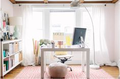 @Alaina Marie Kaczmarski of The Everygirl // office space // large windows // white parsons desk from @Elise West elm // pink greek key rug @Cindy Sullivan USA // @Joss Henry and Main pouf // @IKEA USA expedit shelving // photography by Stoffer Photography