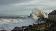"""Waves breaking on the harbour wall during the """"perfect storm"""" of 15 December.  Photo by Amanda Cumming."""