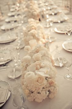 WEDDING PARTY CENTERPIECES. *different flowers* *all bunched like that together all along the table*