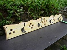 distressed yellow coat rack, hooked on hooks