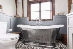 A completed project courtesy of Burlanes Interiors and Sarah London Photography of the classically styled Galleon bath.