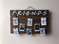 "~ F R I E N D S ~ *i'll be there for youuuuuuu"" This wood sign doubles as a modern/cute/boho-ish home decor piece as well as a place to display (even more) of your favorite people in your life! L I S T I N G I N C L U D E S ≫ 17"" x 10.5"" wood sign, with twine attached ≫ 8 free dark stained"