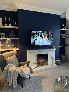Navy wall in living room - Dulux Sapphire Salute Navy Living Rooms, Dark Living Rooms, Feature Wall Living Room, Navy Living Room Decor, Living Room Grey, Blue Living Room Decor, Gold Living Room, Cosy Living Room, Blue Walls Living Room