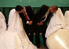 p̶a̶c̶k̶a̶g̶e̶d̶ ̶f̶o̶r̶ ̶l̶o̶v̶e̶   b̶l̶i̶n̶d̶ ̶d̶a̶t̶e̶s̶  t̶h̶e̶ ̶s̶u̶r̶p̶r̶i̶s̶e̶ ̶i̶s̶ ̶u̶n̶d̶e̶r̶ ̶t̶h̶e̶ ̶b̶u̶r̶k̶a̶  l̶o̶v̶e̶ ̶i̶s̶ ̶b̶l̶i̶n̶d̶  An Islamic charity organized a mass wedding for 46 Jordanian and Syrian couples who are unable to afford expensive ceremonies. Brides speak to their grooms during a mass wedding ceremony in Amman on July 6, 2012. http://cnews.canoe.ca/CNEWS/Large_Format_Pix/POD/home.html?=68#