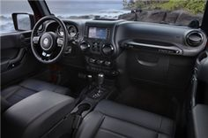 Lawton Jeep Wrangler Unlimited passengers will be riding in style with the inside the 2012 Wrangler Unlimited Altitude, there is red accent stitching on black leather seats, door panels, the center armrest, the floor mats and even the steering wheel.