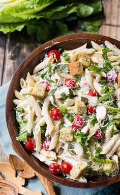 Spicy Southern Kitchen brings this Caesar Pasta Salad with romaine, tomatoes, garlic, parmesan, and penne pasta. This dish will go fast at your next BBQ.