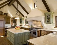 french country kitchen 1 Decorating Style Series: French Country - Like the different color of island and side cabinets