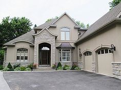 I want my garage door trim to look like this, these garage doors are fine also