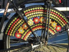 Not a spare tire cover but crochet on a tire none the less....nice pattern that would work just as well for the spare.