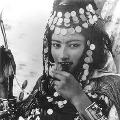 Young Ouled Nail Berber woman of Tunisia, with tattoo and traditional jewelry.…